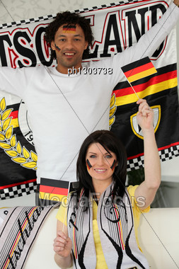 Couple Supporting Germany Stock Photo