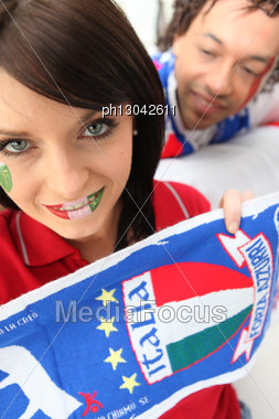 Couple Supporting The Italian Soccer Team Stock Photo