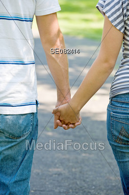 Couple Taking a Walk Holding Hands Stock Photo
