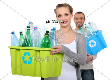 Couple Taking Out The Recycling Stock Photo