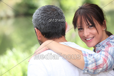 Couple Taking A Walk In The Park Stock Photo