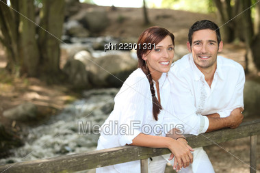 Couple Walking In The Forest Stock Photo