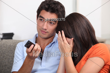 Couple Watching An Horror Movie. Stock Photo