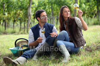 Couple Of Winegrowers With Glasses Of Wine Stock Photo