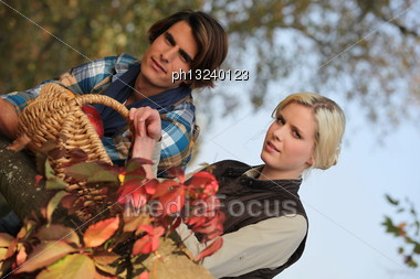 Couple With Basket Stock Photo