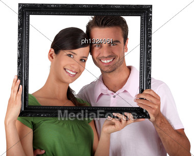 Couple With Empty Frame Stock Photo