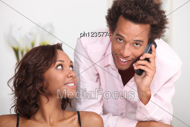 Couple With Phone Stock Photo