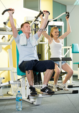 Couple Working Out In Gym Stock Photo