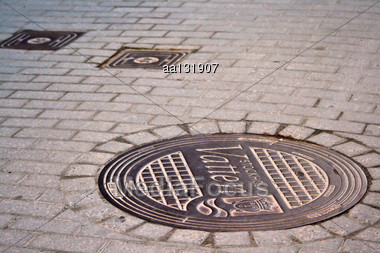 Cover The Wells On The Pavement In The Old Town Of Stockholm Stock Photo