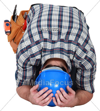 Craftsman Hiding His Face Stock Photo