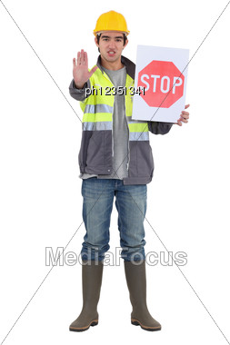 Craftsman Holding A Stop Sign Stock Photo