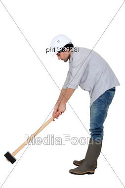 Craftsman Holding An Enormous Hammer Stock Photo