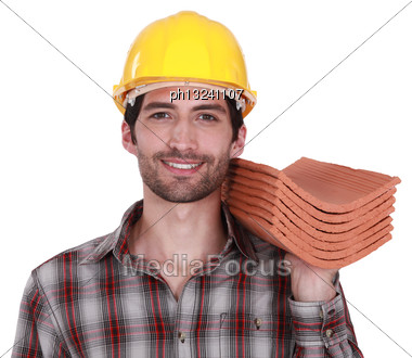 Craftsman Holding Roof Tiles Stock Photo