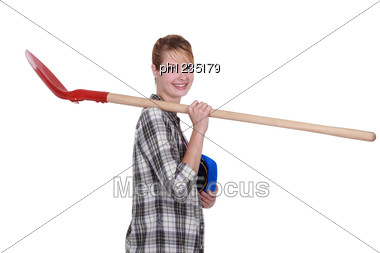 Craftsman Holding A Shovel On His Shoulder Stock Photo