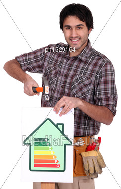 Craftsman Nailing An Energy Consumption Label Stock Photo