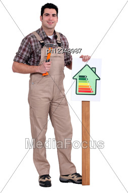Craftsman Putting An Energy Consumption Label Stock Photo