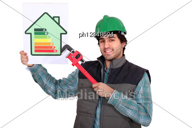 Craftsman Showing The Level Of Energy Consumption Of A House Stock Photo