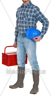 Craftsman Standing With Toolbox And Safety Helmet Stock Photo