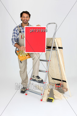 Craftsman With Tools And Red Panel Stock Photo