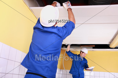 Craftsmen Wiring A Building Stock Photo