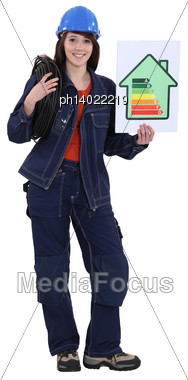 Craftswoman Holding An Energy Consumption Label Stock Photo