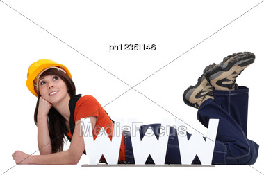 Craftswoman Lying On The Floor With Face Resting On Fist And Www Symbol Stock Photo