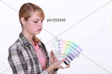 Craftswoman Painter Holding A Color Chart Stock Photo