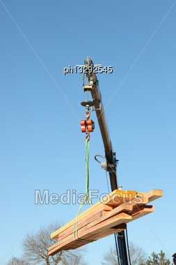 Crane Lifting Timber Stock Photo