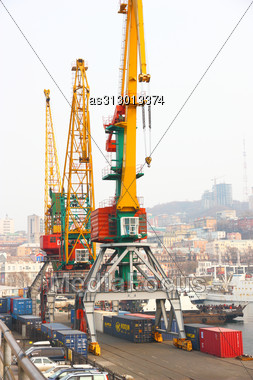 Cranes In Port On A Mooring Stock Photo
