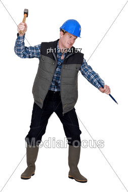 Crazy Man Using A Hammer And Chisel Stock Photo