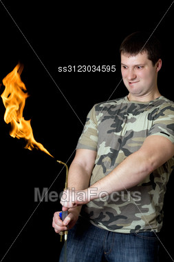 Crazy Young Man With A Gas Torch Stock Photo