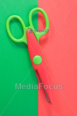 Creativity Concept. Colorful Paper With Child's Scissors Stock Photo
