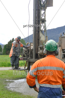 Crew Working A Drilling Rig In The Search For Bore Water, Westland Stock Photo