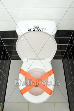 Cross Made From Adhesive Tape, The Sign Do Not Throw Trash In Toilet Stock Photo