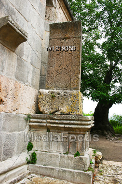 Cross-stone Or Khachkar At The 13th Century Armenian Monastery Of Haghartsin. Khachkars Are Carved Memorial Stele, Covered With Rosettes And Other Patterns, Unique Art Of Medieval Christian Armenia.Th Stock Photo