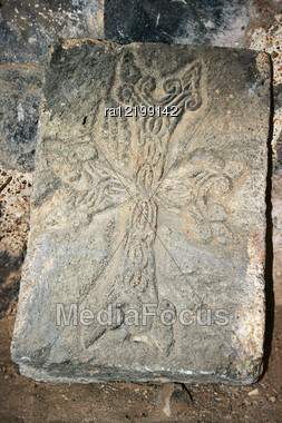 Cross-stone Or Khachkar At The 9th Century Armenian Monastery Of Tatev. Khachkars Are Carved Memorial Stele, Covered With Rosettes And Other Patterns, Unique Art Of Medieval Christian Armenia.There Ar Stock Photo
