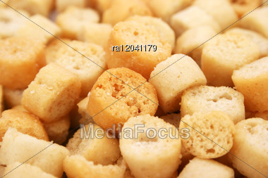 Croutons Closeup Picture As A Background. Stock Photo