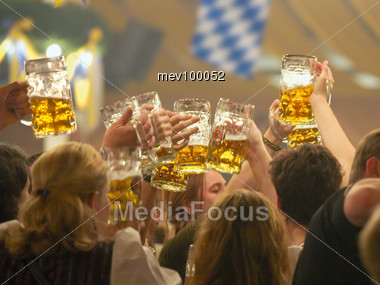 Crowd In The Beer Tent, With Beer Steins Stock Photo