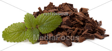 Crushed Chocolate Shavings Pile And Mint Leaf Isolated On White Background Stock Photo