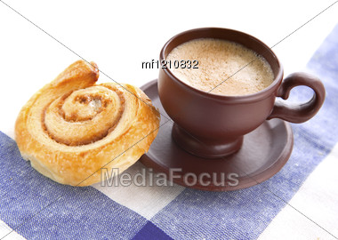 Cup Of Cofee With Cinnamon Danish Bun On Textile Background Stock Photo