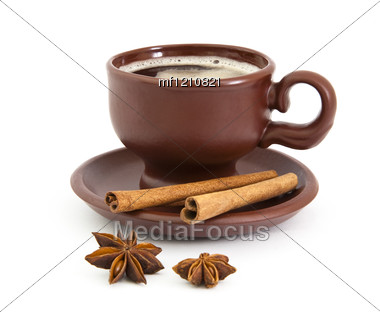 Cup Of Coffee With Anise Star And Cinnamon Stock Photo