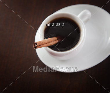 Cup Of Coffee With Chinnamon On The Coffee Beans Backgound Stock Photo
