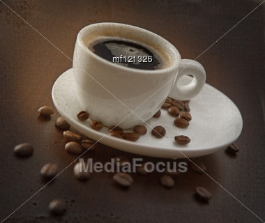 Cup Of Hot Coffee On The Brown Backgound Stock Photo