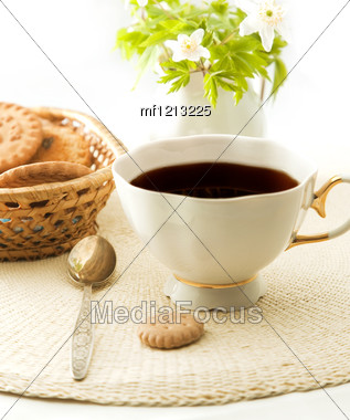 Cup Of Tea With Cookies And Flower As Background Stock Photo