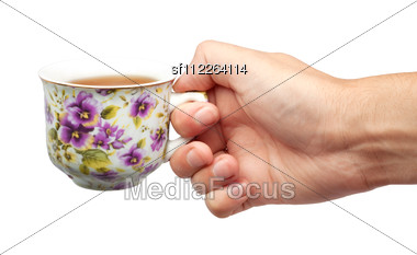 Cup Of Tea And A Hand Stock Photo