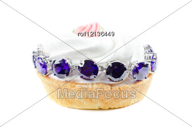 Cupcake And Bijouterie Bracelet With Blue Gems Stock Photo