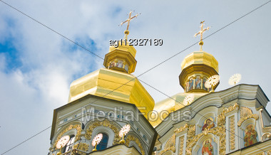 Cupola Of Orthodox Church And Cloudy Sky. Kiev-Pecherskaya Laura. Stock Photo