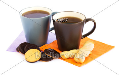 Cups Of Tea And Cookies Isolated On White Background. Stock Photo