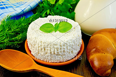 Curd In A Clay Pot With Basil, A Wooden Spoon, Bagel, Dill, Parsley, A Jug Of Milk, A Napkin On A Wooden Board Stock Photo