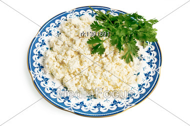 Curd In A Porcelain Dish With A Few Sprigs Of Parsley Isolated Stock Photo
